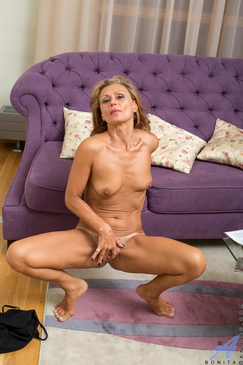 Age is just a number to Bonita, who stays fit and sexy by exercising outside so she also gets a tan. This nicely-proportioned cougar looks lovely in a sheer nightie that lets you admire her dusky nipples and flat stomach. She's even hotter nude as she fin