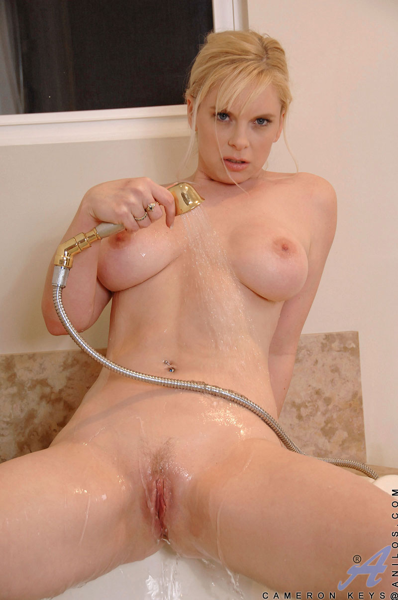 Busty blonde cougar teases her big tits and fresh pussy in the bath tub