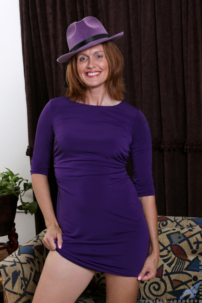 Sassy milf Camille Johnson loves to play! Join her as she shows her fun side by undressing slowly until her bare body is open for your admiration. Her soft boobs and landing strip pussy need more stimulation than her fingers can give, though, so she turns