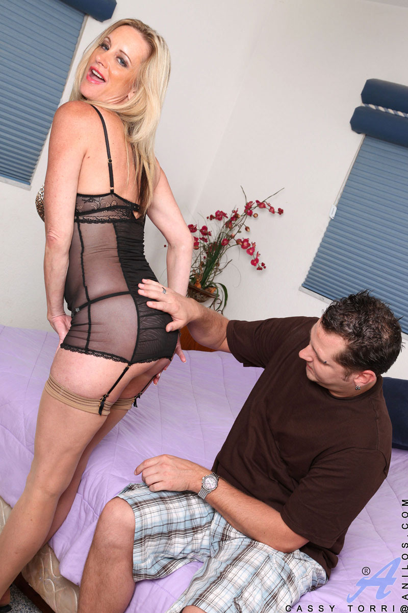 Sexy cougar Cassy Torri uses her big tits and hot body to seduce a younger stud for a hardcore pussy pounding and a load of cum in her mouth