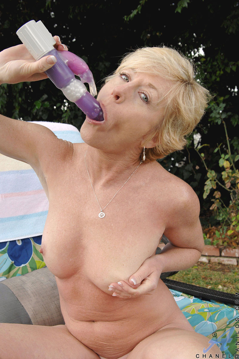 Horny cougar housewife gets ready to play with her pussy outdoors