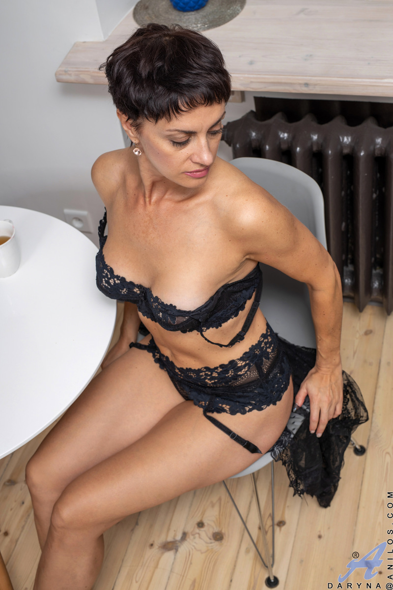 Daryna may be in her 40s, but this fit mommy is stacked and wants to show herself off to the world. Look at the way she fills out her lingerie and sheer robe. You'd better be quick, because once this horny milf starts stripping and feeling herself up she