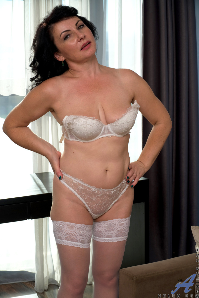 Helen He is the type of gorgeous housewife you'll want to take home and fuck! This hot mama is willing and ready, flaunting her big breasts and big areolas as she strips slowly. When she spreads her thighs and shows off the creamy wetness of her bare twat