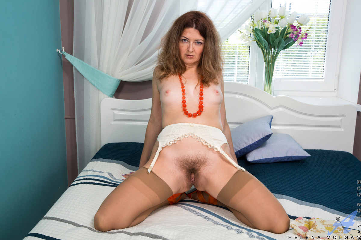 Whenever Helena Volga is bored and lonely, she relocates to the bedroom and starts peeling off her clothes. She'll take the time to play with her small hanging boobs and diamond hard nipples, but her real goal is for her magic fingers and vibrating toy to