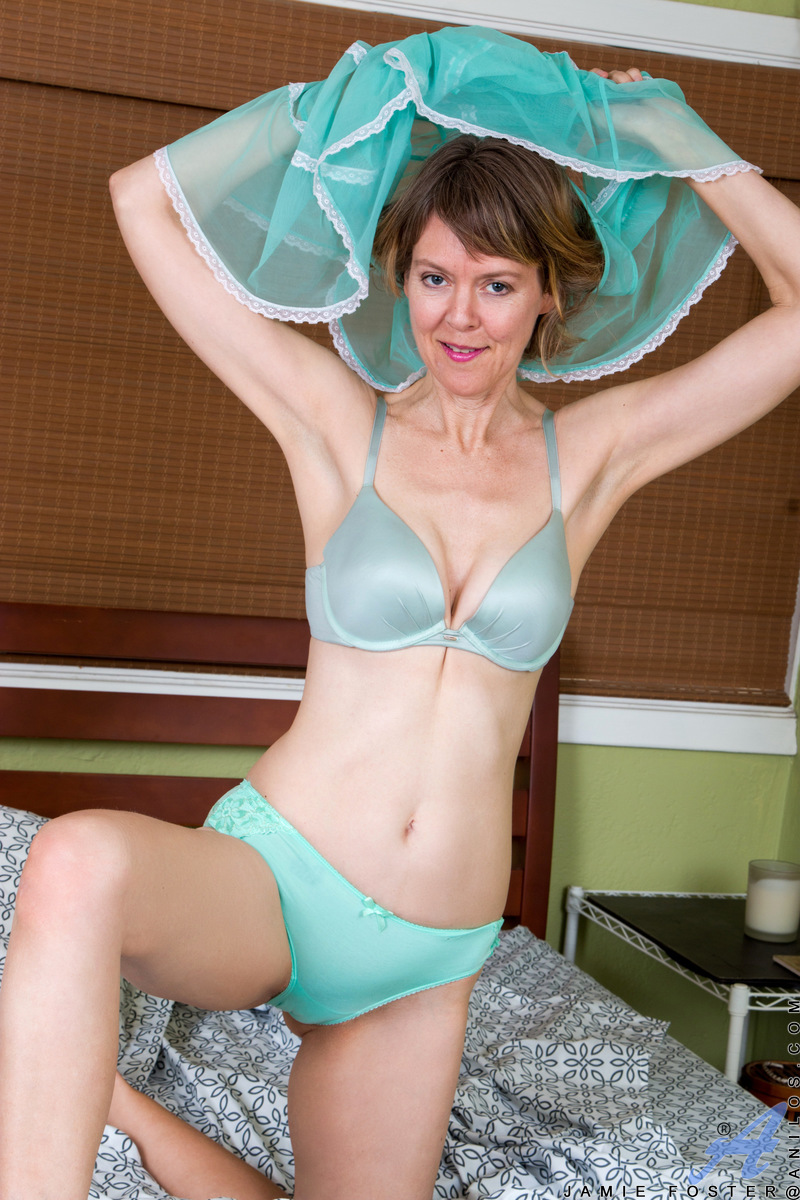 Always up for a good time, 48 year old Jamie Foster still enjoys dressing in sheer clothes that show off her slender figure and fair skin. She's not shy about taking her clothes off as her desire grows, leaving her all natural breasts and creamy cunt open