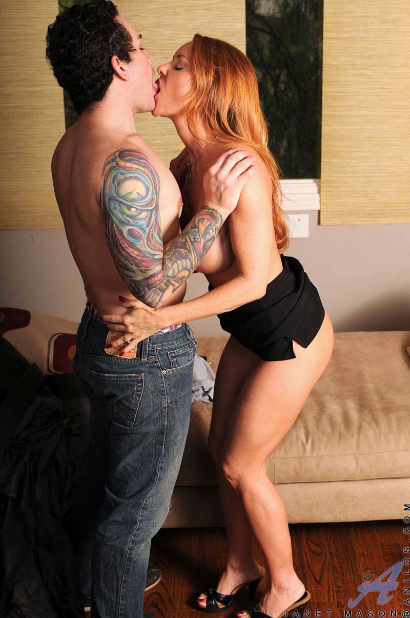 Busty redhead Janet Mason gets bent over to get a hard dick doggystyle