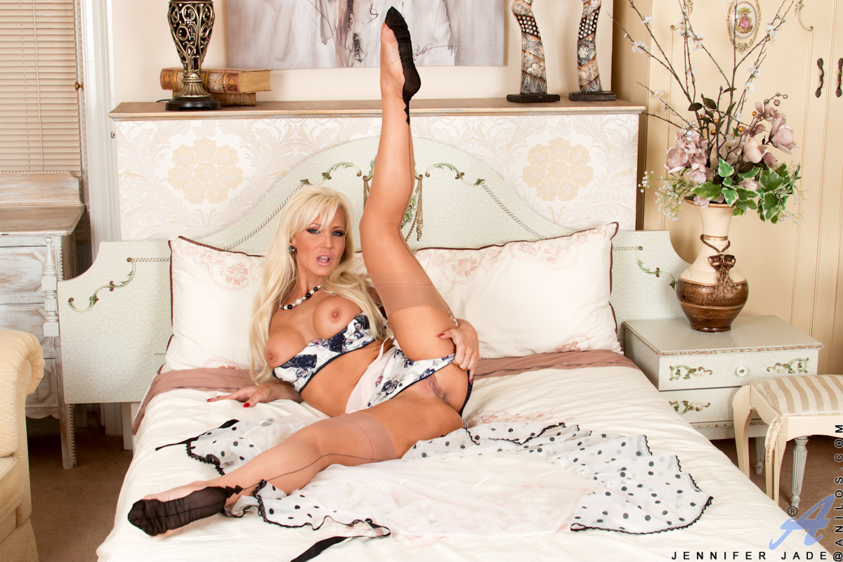 Check out total milf Jennifer Jade, the UK mom who will do anything to satisfy the needs of her horny shaved pussy! She starts off her evening of self-pleasure wearing a sheer robe over a bra and panties, but soon her clothes are but a memory as her hands