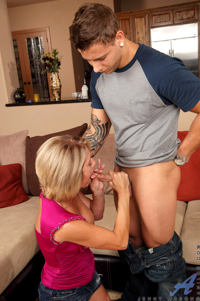 Mature Jenny Mason rubs her pussy under a miniskirt exposing ample breasts for a hardcore anal encounter with a shiny new cock