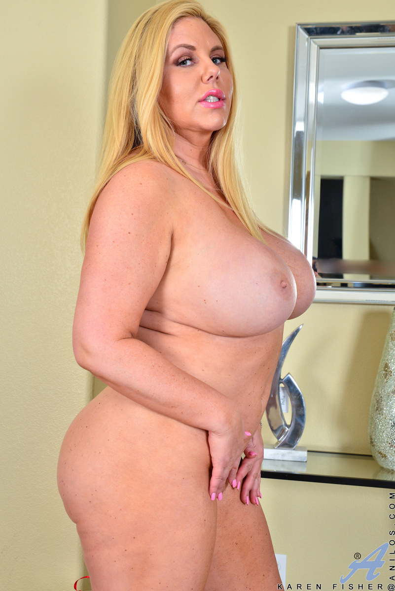 Karen Fisher has the most amazing big titties we've seen in a long time. This voluptuous American milf will haunt your dreams, especially once you've seen her kick off her high heels, peel off her dress, and then go to work pleasing every inch of her thic