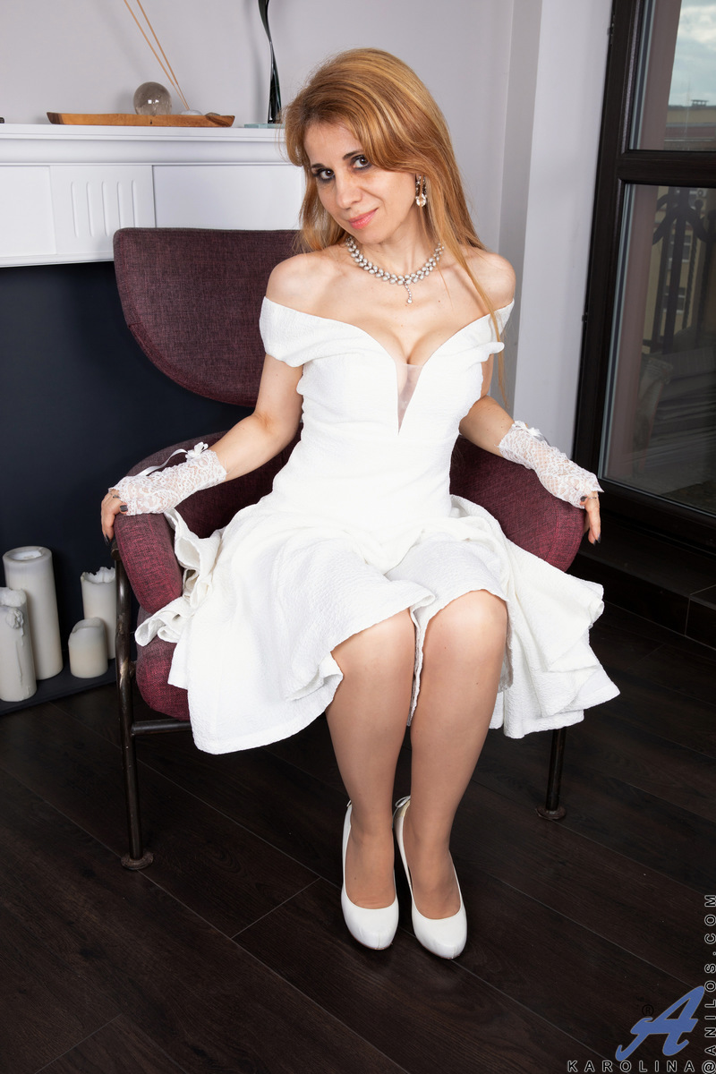 Getting herself off is Karolina's favorite pastime, and this horny mom won't wait for anyone. She may look good in white, but she is even hotter as she gets naked. Cupping her breasts and then sliding her hands lower, she works herself towards a big O wit