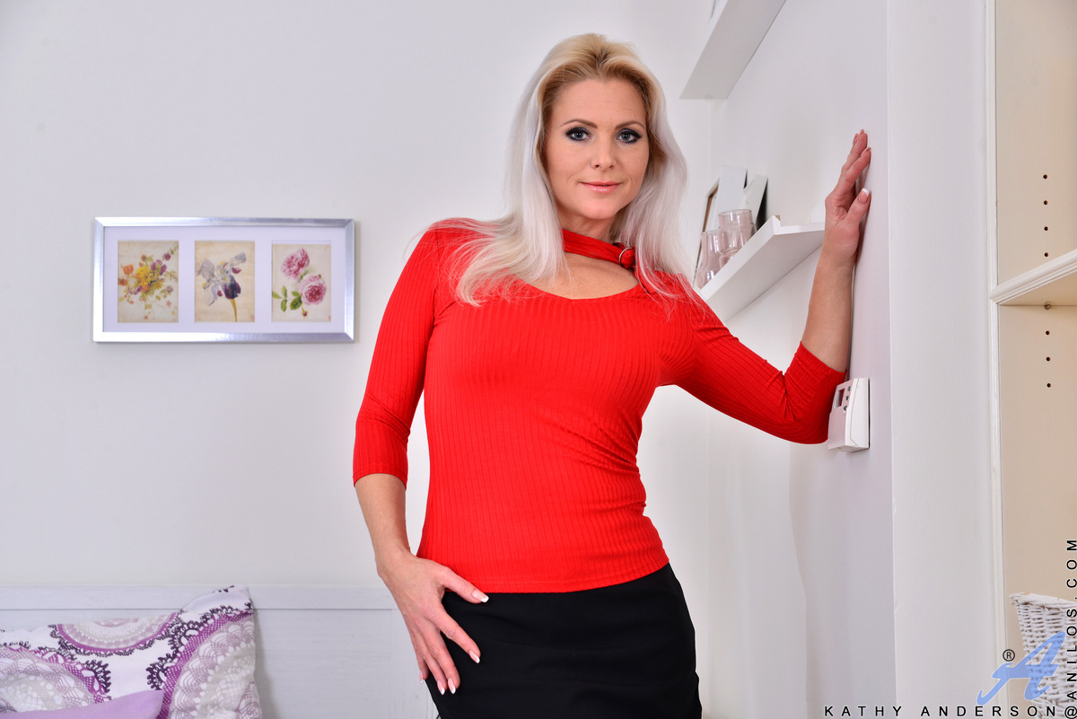 Czech mom Kathy Anderson is back for another round of mature fun! Stroking her ass and landing strip twat beneath her miniskirt and pantyhose, she takes a detour to caress her hanging tits. This all natural blonde will stop at nothing to get her fuck hole