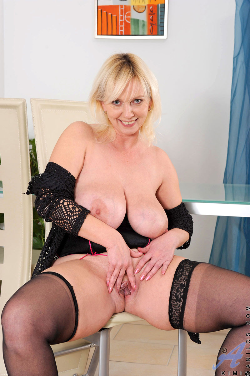 Horny Cougar Kimi releases her huge natural tits from her lingerie and stuffs her needy pussy full of vibrator