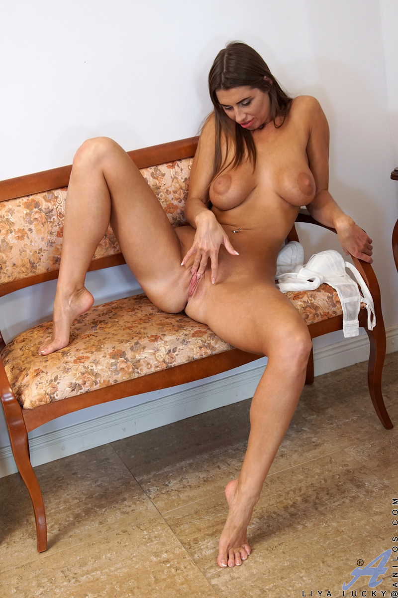 Russian mom Liya Lucky will light up your life with her huge enhanced tits and her perfect firm ass. This tanned toned housewife is as sensual as they come, peeling off her bra to squeeze her big boobs and then her thong to plunge two fingers deep into he