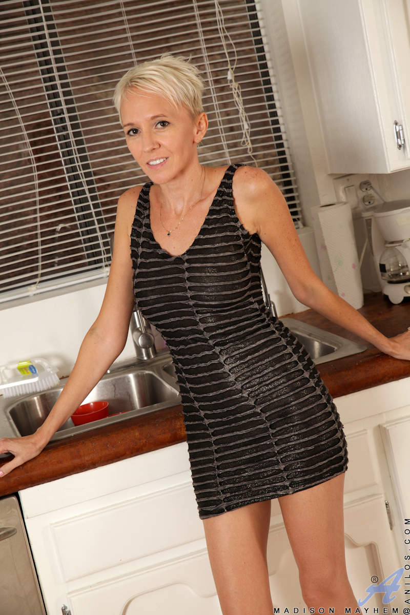 Mature blonde babe Madison Mayhem dresses in tight short dresses that accentuate her stunning body. After pulling up her miniskirt to show that she's not wearing any panties, Madison realizes that she's too horny to stop touching her bald twat. The sex cr