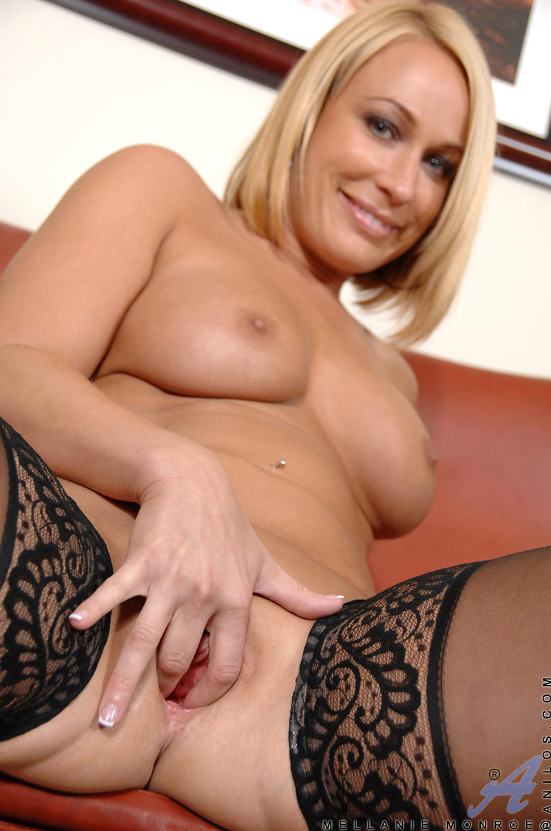 Mellanie Monroe uses her fingers to pleasure her shaved pussy