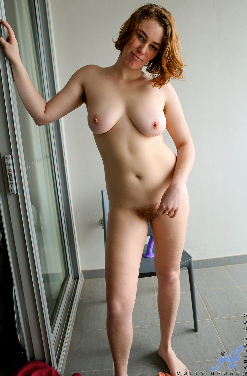 A flowing red dress makes Molly Broad look like a star, especially as she starts pulling out those big titties of hers. This Australian redhead is stunning and sensual as she peels off her clothes and grabs a dildo to ride until her cum craving twat is pu
