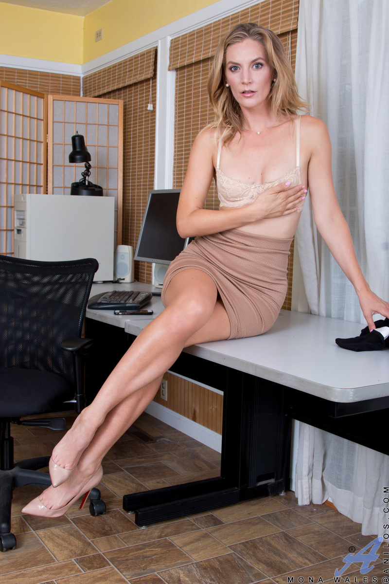 When American businesswoman Mona Wales is done with work, she pulls her demure clothes off and drops her bra and panties to the ground. This repressed milf can't wait another moment to fondle her natural hanging boobs and slide her fingers down her dewy s