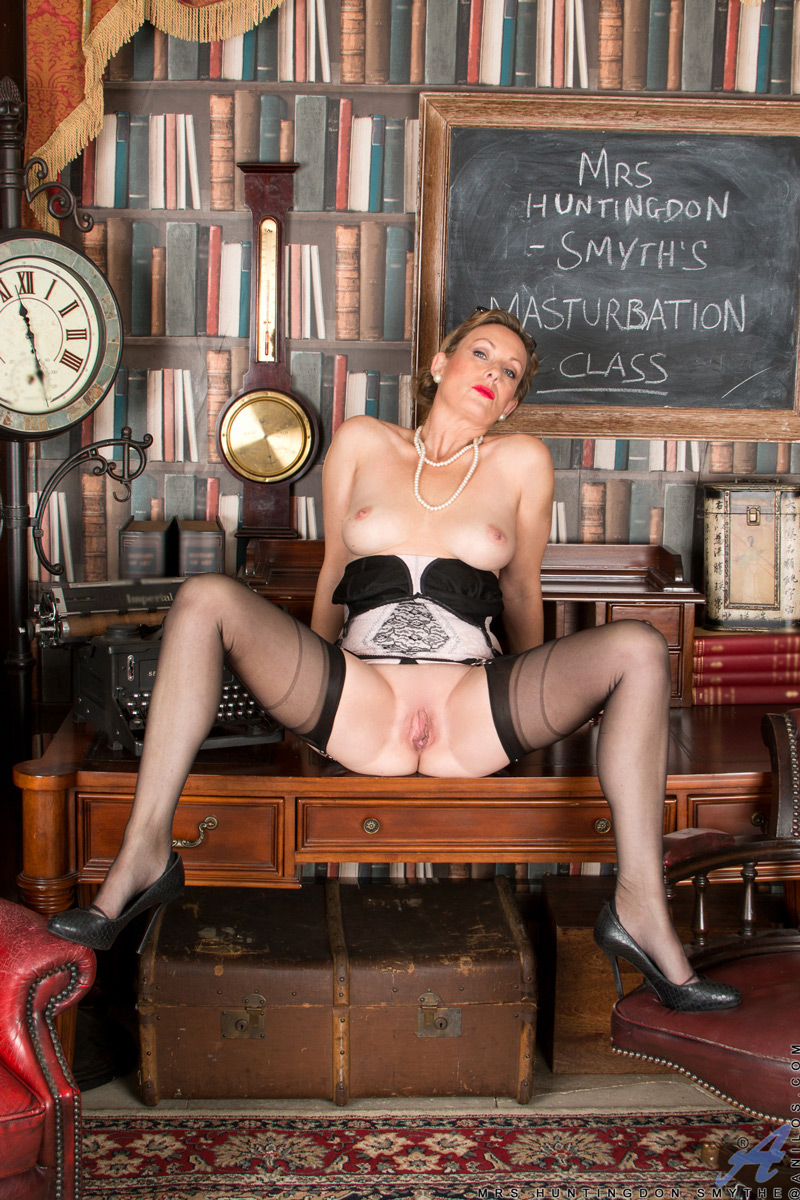 It's time to learn about masturbation from the luscious Mrs. Huntington Smythe! The teacher is ready to use herself as a model for her lessons, so she gradually works her way out of her severe clothing until she is able to play with her all natural boobs