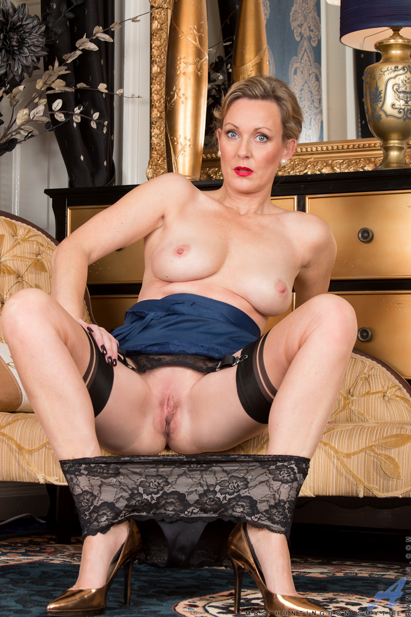 Luscious milf Mrs. Huntington Smythe is ready to show you the treasures of her 43 year old body. A sultry dress with a short miniskirt teases at her mature body, but the real show begins as her clothes come off to reveal her medium boobs and her delectabl