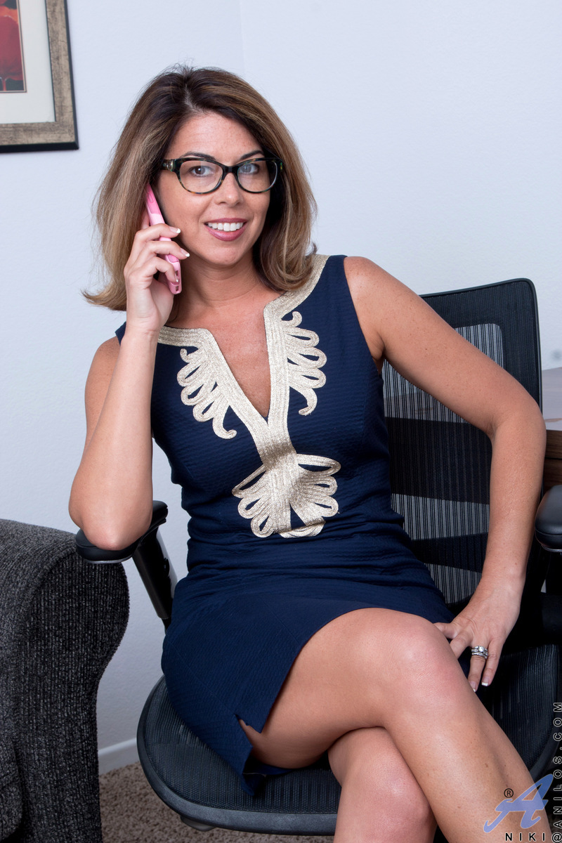 American milf Niki wears glasses and short skirts to work. When she's done for the day, she peels off her bra and sheer thong. She's still got an amazing body at 40, and this busty mom likes to flaunt it by getting naked and striking a variety of pussy pl