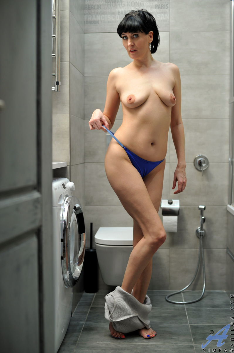 When Nimfa is feeling dirty, the horny mom is quick to jump into the shower where she peels off her clothes and massages her big boobs while licking her own nipples. Turning on the spray, she wets herself down and then aims the water at her bare twat to d