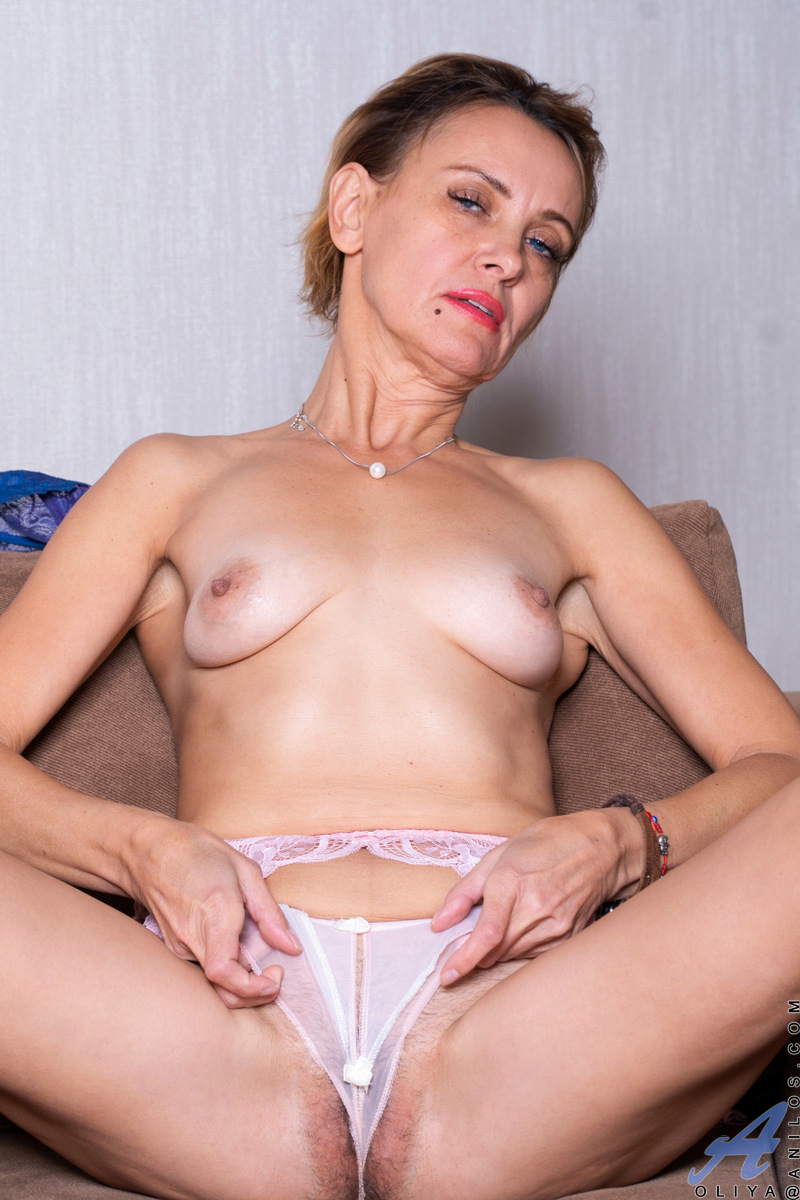Sweet and sexy Oliya is looking fine in lingerie that hugs her womanly curves. This hot housewife will draw you in with her seductive charms as she strips and uses her talented hands to show off her full boobs and puffy nipples. When she starts masturbati
