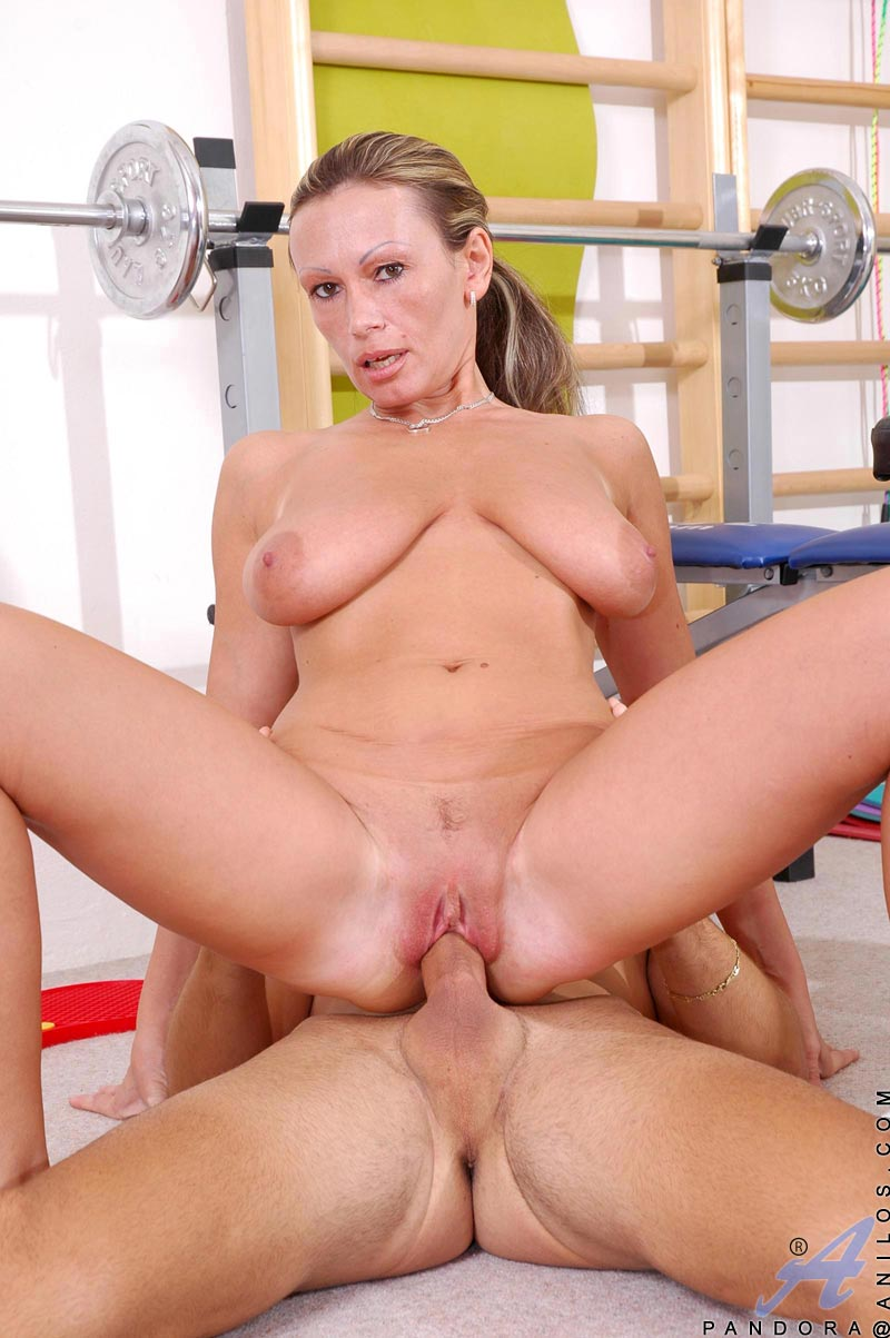 Long haired Anilos Pandora with huge tits gets a hard fucking by a young gym instructor