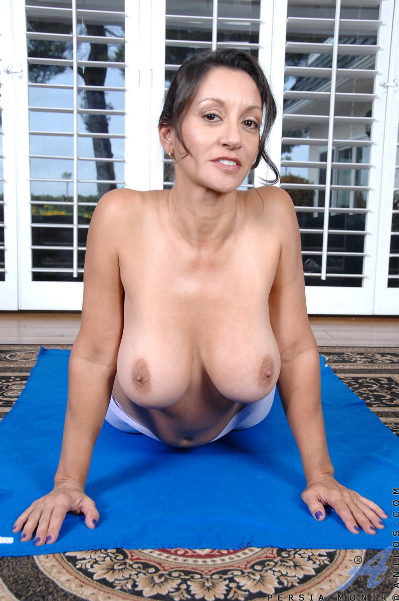 Milf with big natural boobs stretches her body while doing yoga