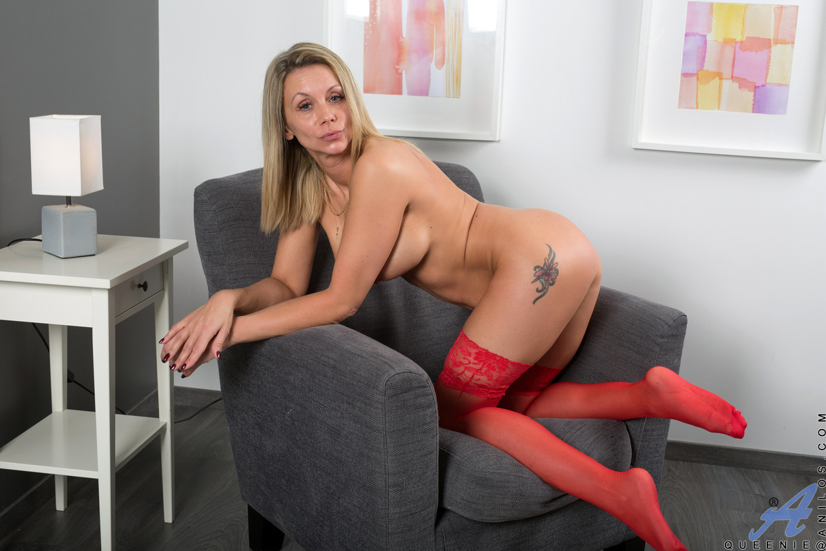 Fair skinned babe Queenie shows off her incredible breasts and flat belly with red lingerie that leaves nothing to the imagination. Peeling off her sheer outfit, she spreads her stocking clad legs and plunges two fingers deep into her cock craving twat to