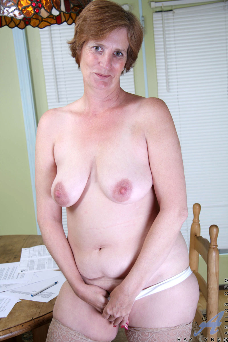Cute red haired granny fingers her pussy at Anilos