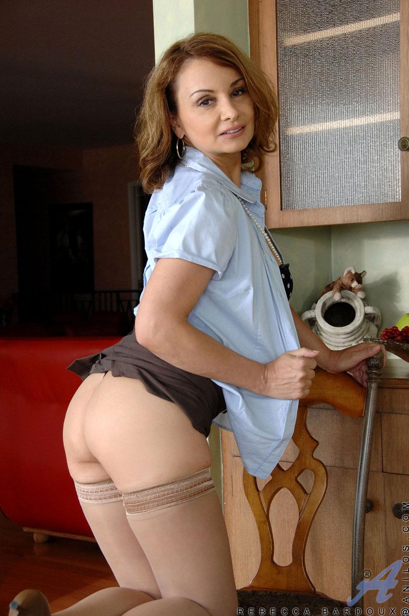 Alluring brunette office manager masturbates during her break