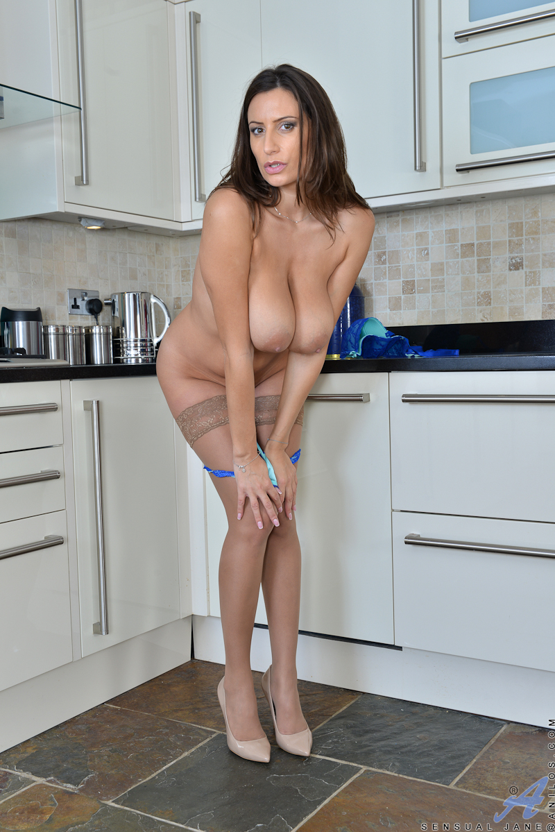 32 year old Sensual Jane has huge tits that she just can't bear to keep hidden. Enjoy the show as she peels off her bra and thong, letting her busty boobs hang free so you can admire them before checking out her landing strip pussy that creams with excite