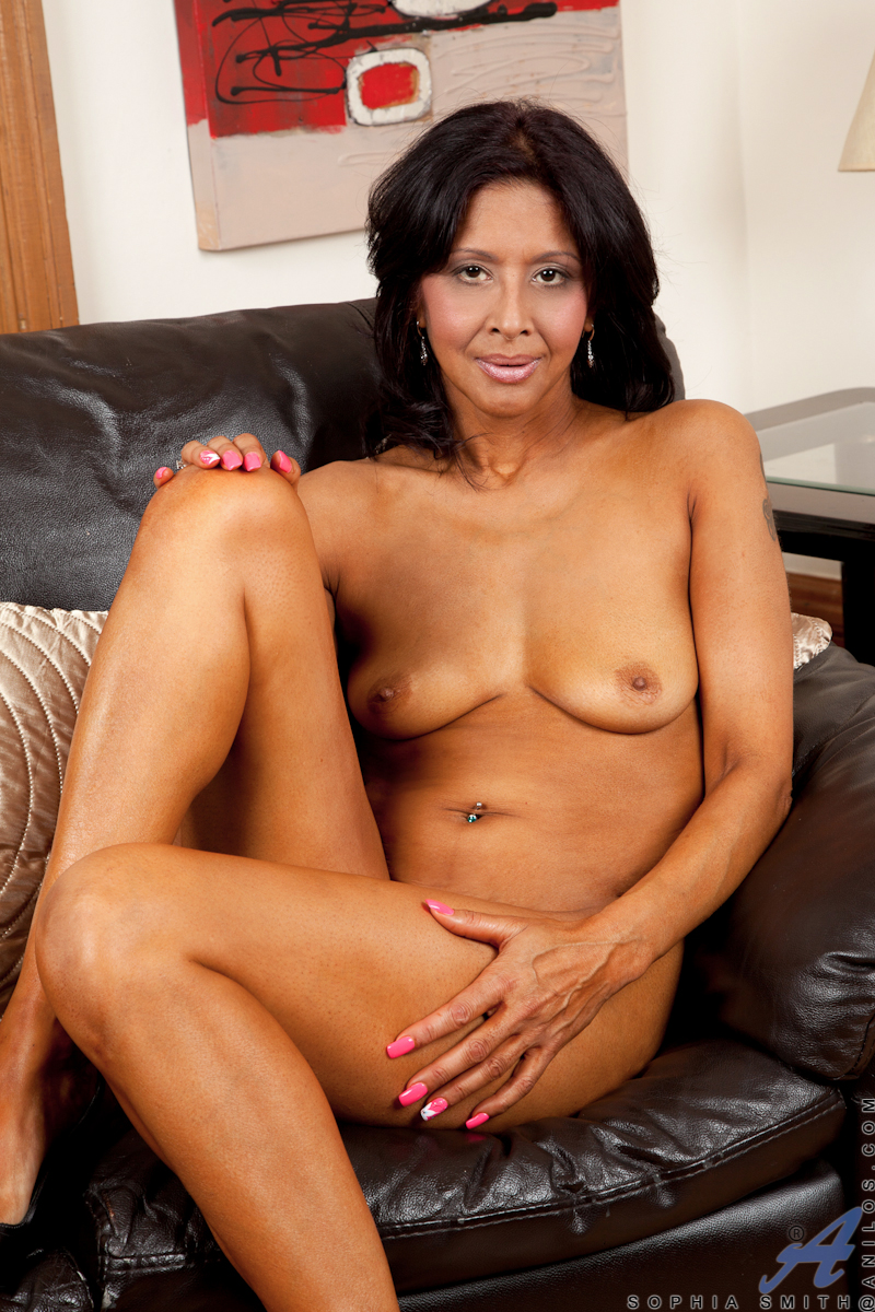 47 year old Sophia Smith is a bronzed goddess whose toned body is hot as hell. Watch as this cock hungry milf strips out of her bra and panties to show off her all natural boobs and her flat belly. By the time her long legs go up in the air to expose her