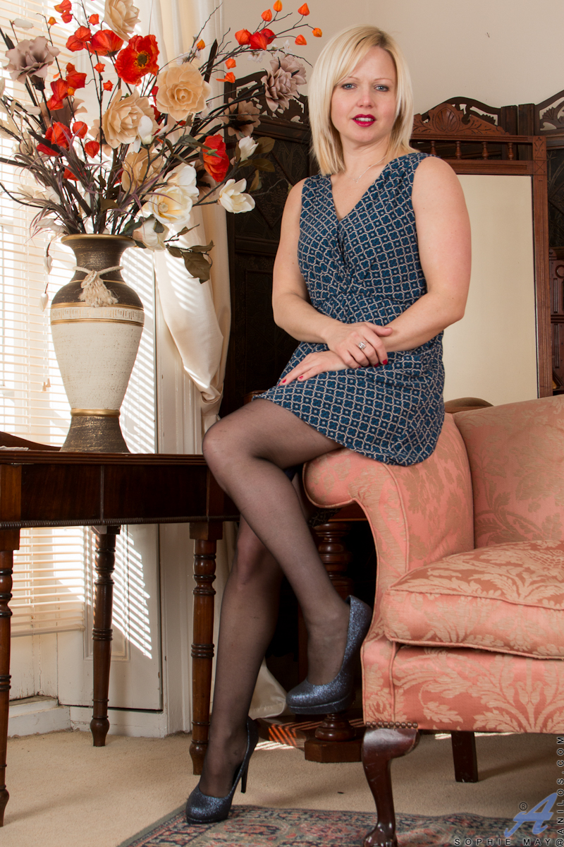 34 year old milf Sophie May is looking hot in a dress with a short miniskirt that lifts to reveal her sheer panties and thigh high stockings. This horny housewife has a great surprise when she slips out of her dress to reveal lingerie underneath. Things o