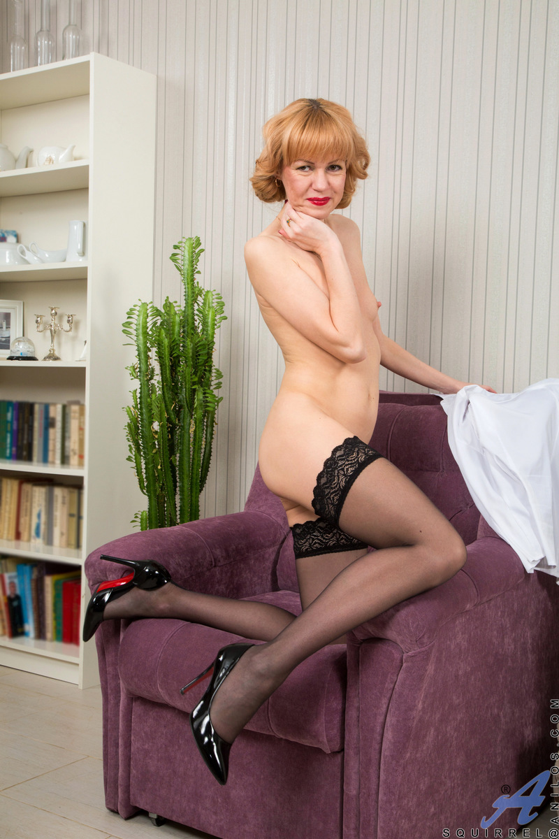 Mature Russian gilf Squirrel has still got what it takes to seduce anyone she wants. The seductive redhead hikes up her miniskirt and slips her thong off, then strips down to her thigh high stockings. Pulling out a vibrating dildo, she shows us just what