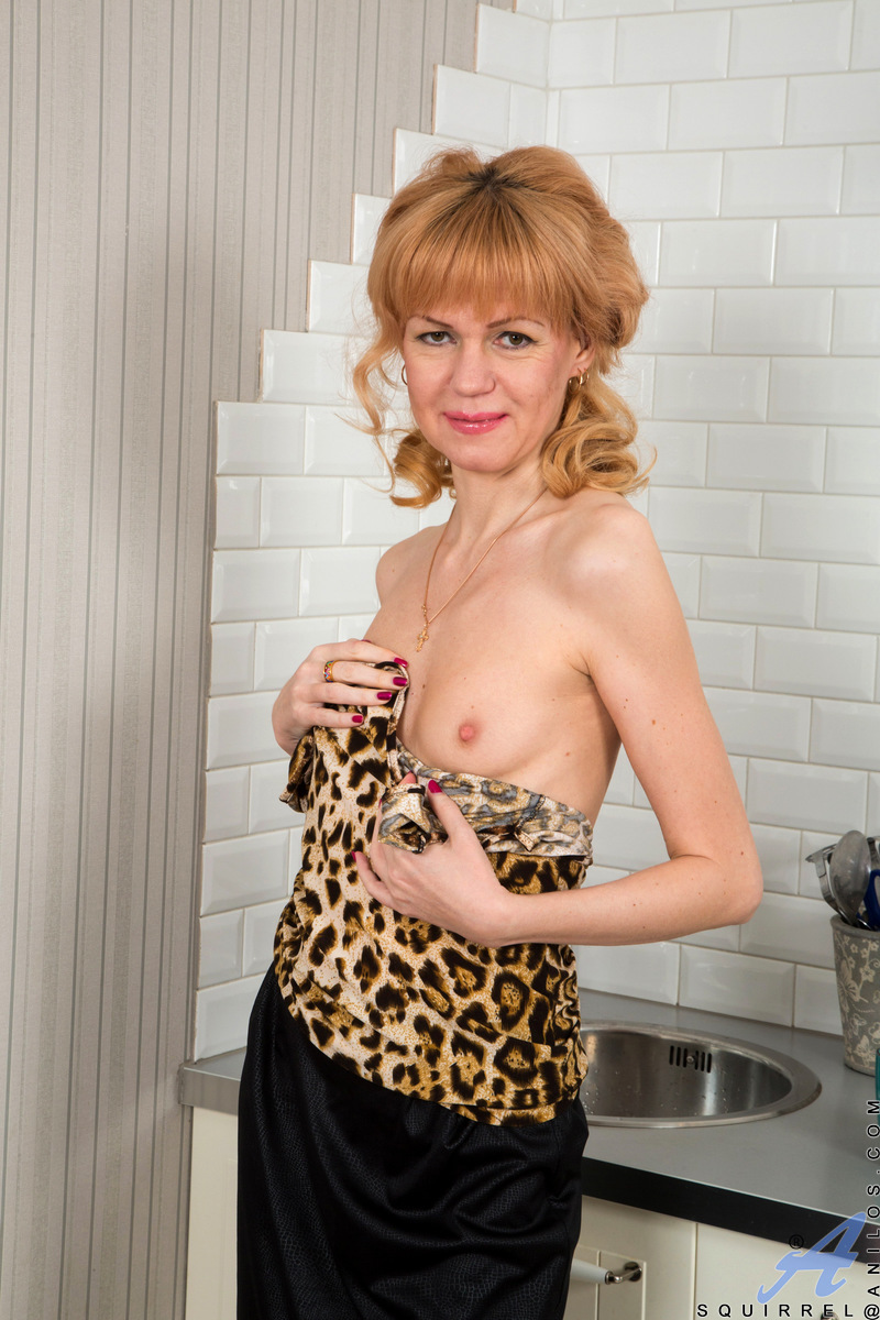 Russian granny Squirrel is a classy lady with a body you'll love. Peeling off her dress and thong, she has some fun in the kitchen caressing her small all naturals. Once her bald twat is nice and wet, she moves to the living room where she delivers an org