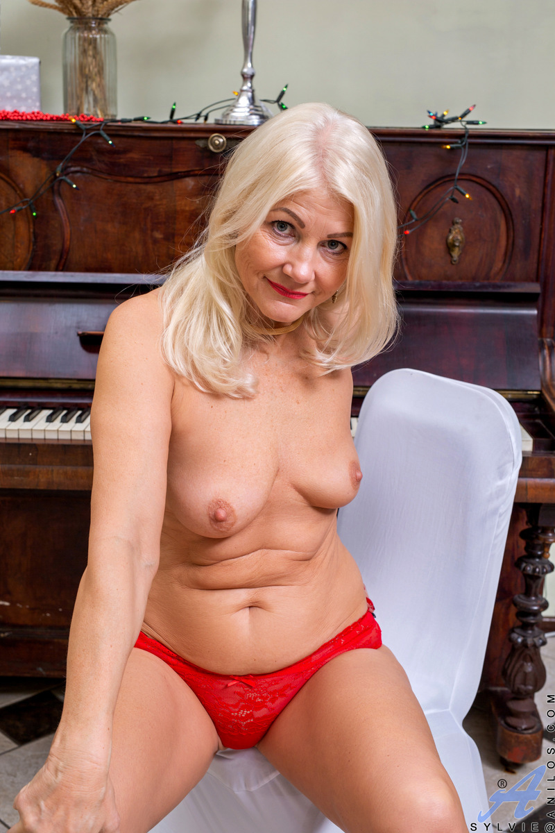 Let lush blonde Latvian Sylvie be your holiday wish. This horny cougar is slow and sexy as she takes it all off, revealing her stunning breasts and nice ass that she loves to show off. This smokin' hot housewife is ready to let her bare pussy call the sho