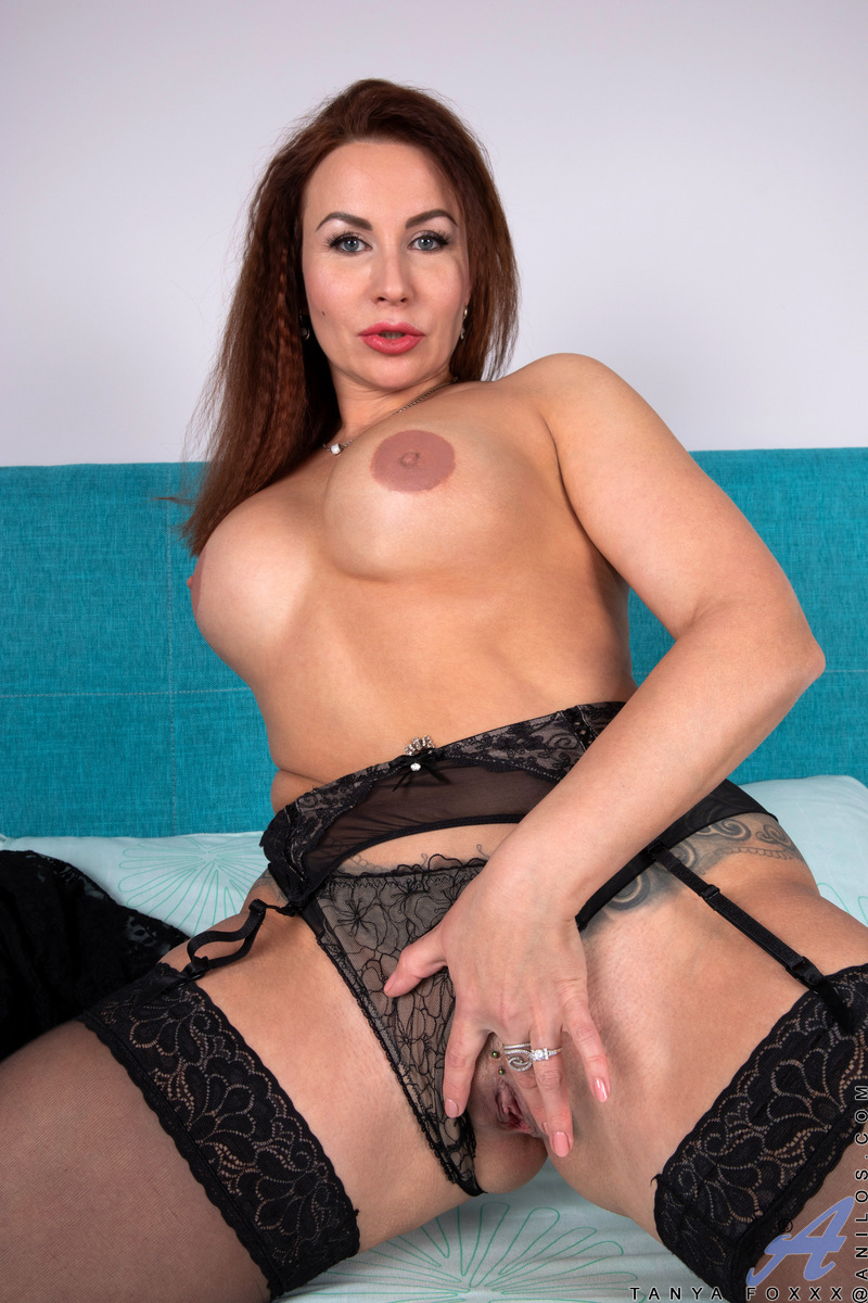 Lusty and busty housewife Tanya Foxxx can't seem to keep her hands off her cum hungry body. Her nipples harden beneath the touch of her fingers, but the real goal of her evening is hopping on top of a hard dildo and riding it until her greedy cunt is puls