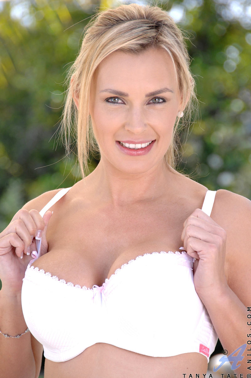 Alluring Anilos Tanya Tate strips down to her bra outdoors