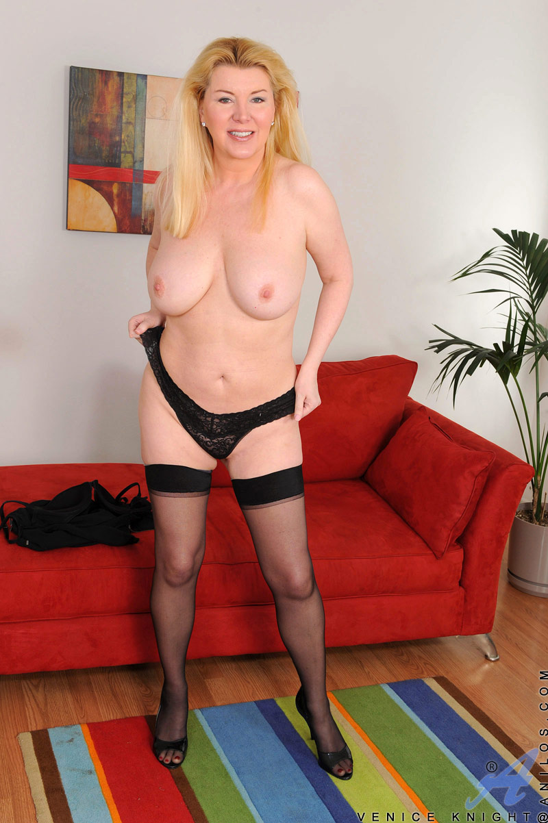 Intelligent blonde lady in glasses slips off her work suit