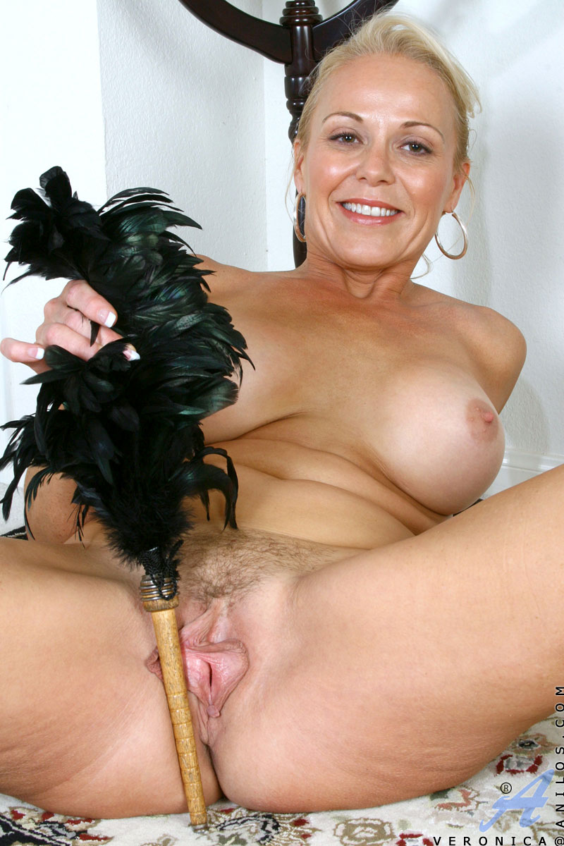 Horny french maid stretches her hairy mature pussy