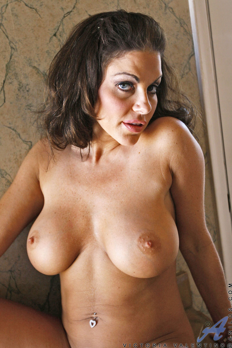 Brunette milf goddess Victoria Valentino massages her colossal tits and delicate pussy