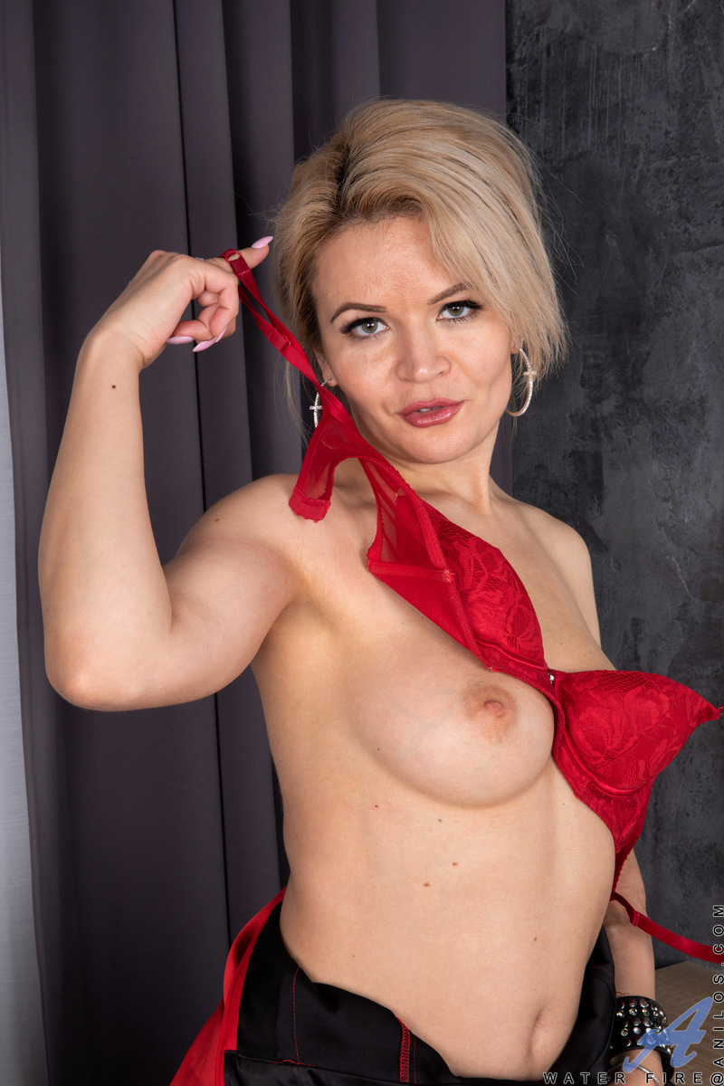 Stunning in red from her shirt to her high heels, Water Fire is a ravishing housewife who's ready to let loose. Her red bra and thong are there to catch your eye and draw you into her passionate web. Once she has you, she keeps up the seduction as her fin