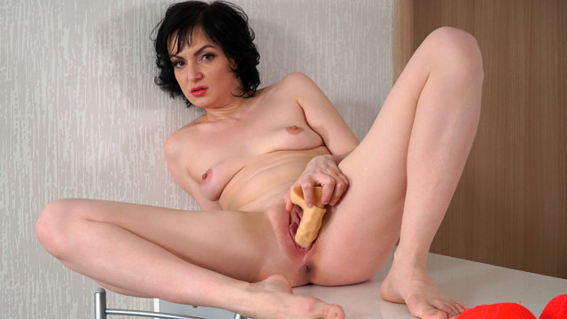 We love how adventurous Darla is as the brand new housewife slips out of her bra and thong. Her softly curved body on display, Darla grabs a big dildo and hops on the counter with her thighs spread to show us how easily her bare fuck hole can take a pussy pounding.